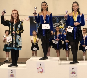 Irish Dancers from the Artz Collective on the podium 1st, 2nd 3rd at The Unicorn Feis